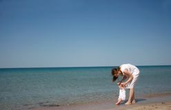 Mother and baby on beach Stock Images