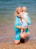 Mother with baby on the beach Royalty Free Stock Image