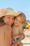 Mother and baby on the beach Stock Images