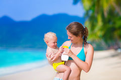 Mother and baby at a beach Royalty Free Stock Photos