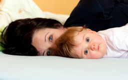 Mother and baby in bed Royalty Free Stock Image
