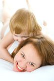 Mother an baby in bed Royalty Free Stock Photography