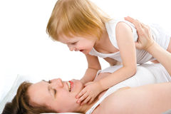 Mother an baby in bed Royalty Free Stock Photos