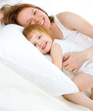 Mother an baby in bed Stock Photography