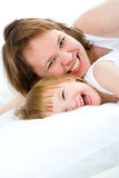 Mother an baby in bed Stock Photo