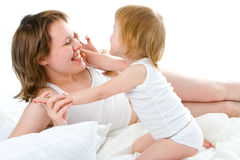 Mother an baby in bed Royalty Free Stock Image
