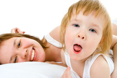 Mother an baby in bed Stock Images
