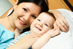 Mother and baby on the bed Stock Images
