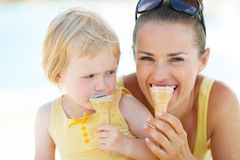Mother and baby biting ice cream Stock Image