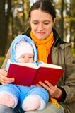 Mother and baby with book Stock Photo