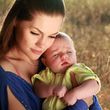 Mother and baby boy. Attractive young mother and little baby boy outdoors Royalty Free Stock Images