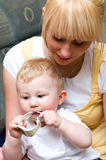 Mother with baby boy. Happy young mother playing with cute baby boy Royalty Free Stock Photo