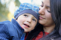 Mother and Baby Boy. Baby boy with mother play in park Royalty Free Stock Image