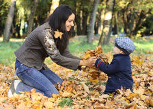 Mother and Baby Boy. Baby boy with mother play in park Royalty Free Stock Images