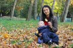 Mother and Baby Boy. Baby boy with mother play in park Stock Photos