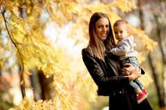 Mother and baby boy in autumn park royalty free stock photo