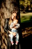 Mother and baby boy in autumn park royalty free stock photography