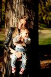 Mother and baby boy in autumn park stock photo
