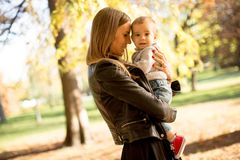 Mother and baby boy in autumn park royalty free stock images