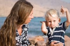 Mother and baby boy at the beach Stock Images