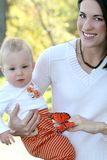 Mother and Baby Boy with Butterfly - Fall Theme Royalty Free Stock Photography