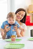 Mother With Baby Boy Celebrating Birthday At Home Stock Photos