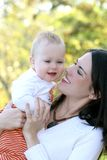 Mother and Baby Boy  - Fall Theme Royalty Free Stock Image