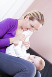 Mother and baby boy in the living room to play. Stock Image