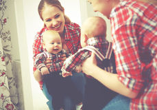 Mother and baby boy look in mirror  at home Stock Image