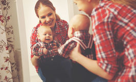 Mother and baby boy look in mirror  at home Royalty Free Stock Image