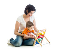 Mother and baby boy play with counter Royalty Free Stock Photography