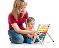 Mother and baby boy play with counter toy Stock Images