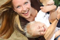 Mother and Baby Boy Playing stock images