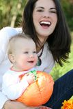 Mother and Baby Boy with Pumpkin - Fall Theme Royalty Free Stock Images