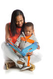 Mother and Baby Boy Reading Book Together Stock Photos