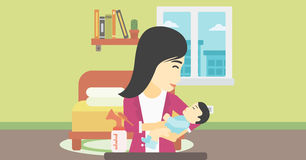 Mother with baby and breast pump. An asian mother holding a newborn baby in hands and a breast pump standing on the table in front of her. Young mother feeding Royalty Free Stock Image