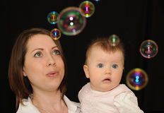 Mother with baby and bubbles Stock Image