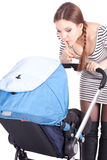Mother with baby buggy keeping silence Royalty Free Stock Photography