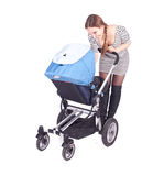 Mother with baby buggy (stroller) Stock Image