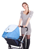 Mother with baby buggy (stroller) Stock Images