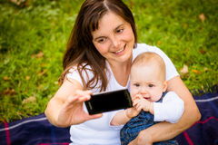 Mother and baby - capturing moments Royalty Free Stock Image