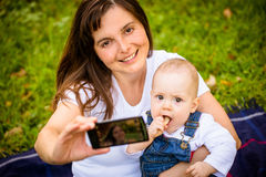 Mother and baby - capturing moments Royalty Free Stock Images