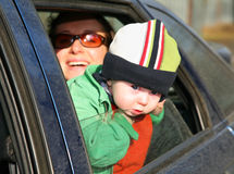 Mother with baby in car Royalty Free Stock Images