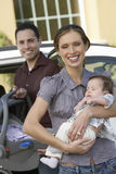 Mother With Baby By Car Royalty Free Stock Image