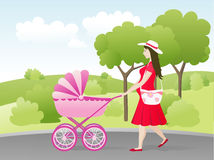 Mother with baby carriage Stock Photo