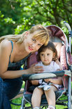 Mother with baby carriage Royalty Free Stock Photos