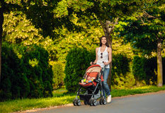 Mother with baby carriage outdoor summer Stock Photography
