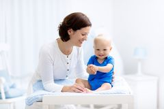 Mother and baby on changing table Royalty Free Stock Photos