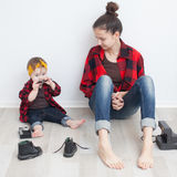 Mother and baby in checkered shirts and jeans royalty free stock image