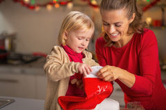 Mother and baby with christmas stocking Stock Images